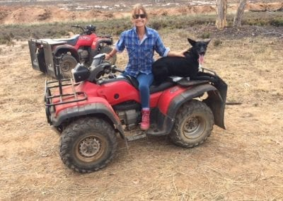Rhonda on her quad bike with her dogs